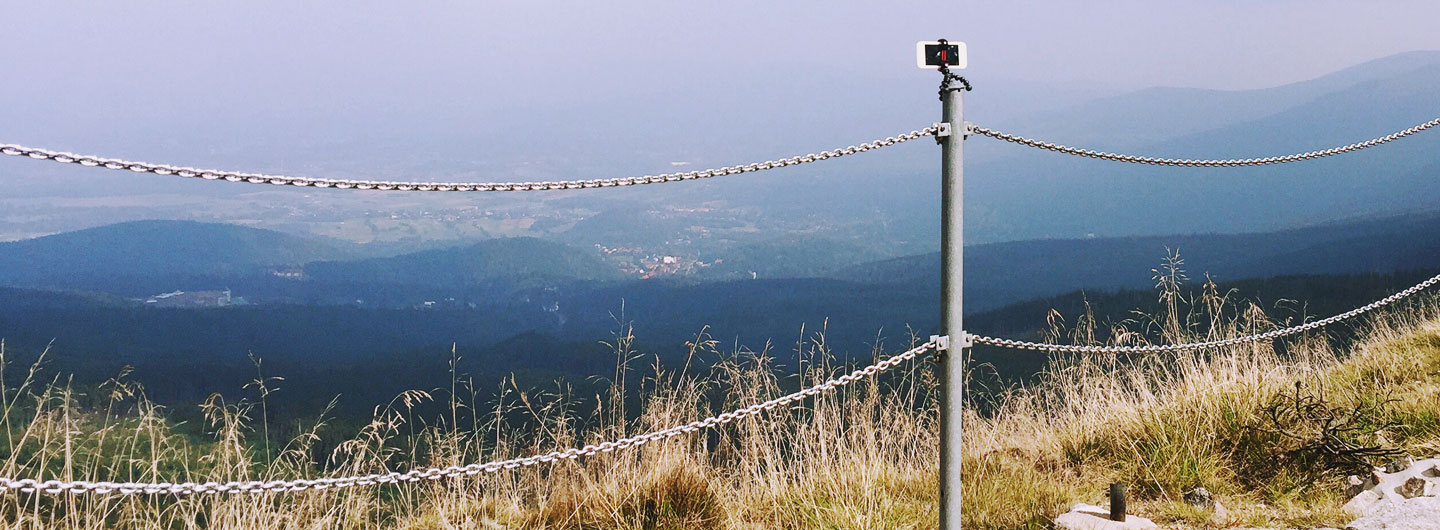 iPhone mounted on a post to make a photo of a landscape